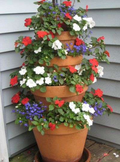 The Terra Cotta Pot Flower Tower is made by using terra cotta pots in descending sizes, stacked on top of one another. The tower of pots (anchored together by a long pole or dowel rod) allows you to plant terraced rows of flowers that cascade downward.