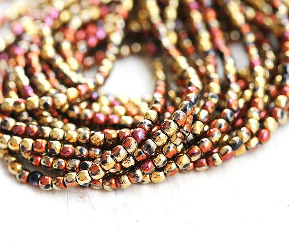 Material: Czech Glass beads  Colors: Golden mixed color  Size: 2mm  Other: round spacer beads, druk  Quantity: 150beads - full strand 11