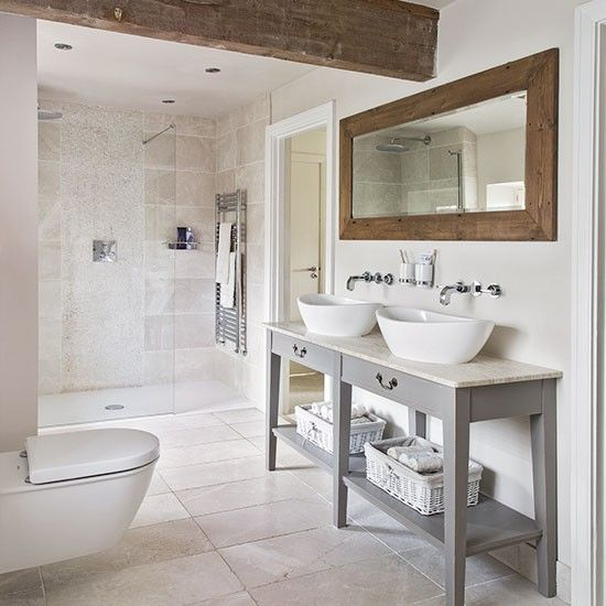Neutral tiled bathroom with wooden beams. Barrier-free access to shower. Wall mounted toilet. Wall mounted faucets. http://www.housetohome.co.uk/bathroom/picture/neutral-tiled-bathroom-with-wooden-beams