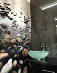Stone and water themed printed acrylic splashback used as feature wall in bathroom. Simply stunning. #printedsplashbacks