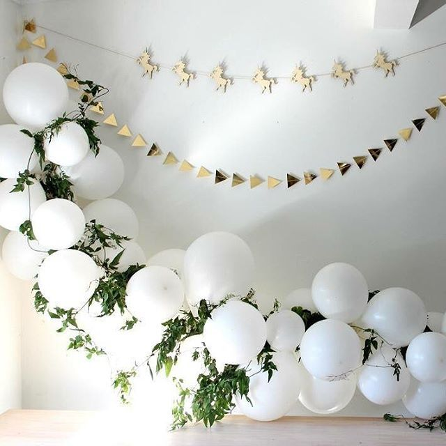 White balloon art with foliage to decorate! Golden garlands. Very fancy