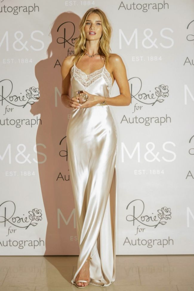 """Held at Cafe Royal on January 28th, 2015, model Rosie Huntington-Whiteley attended the launch of her fragrance called """"Rosie for Autograph"""". The blonde beauty opted to wear sleep wear at the event with a silk nightdress from her lingerie collection with Marks and Spencer's Autograph line. Rosie paired the look with Jimmy chop shoes and a silver choker necklace."""