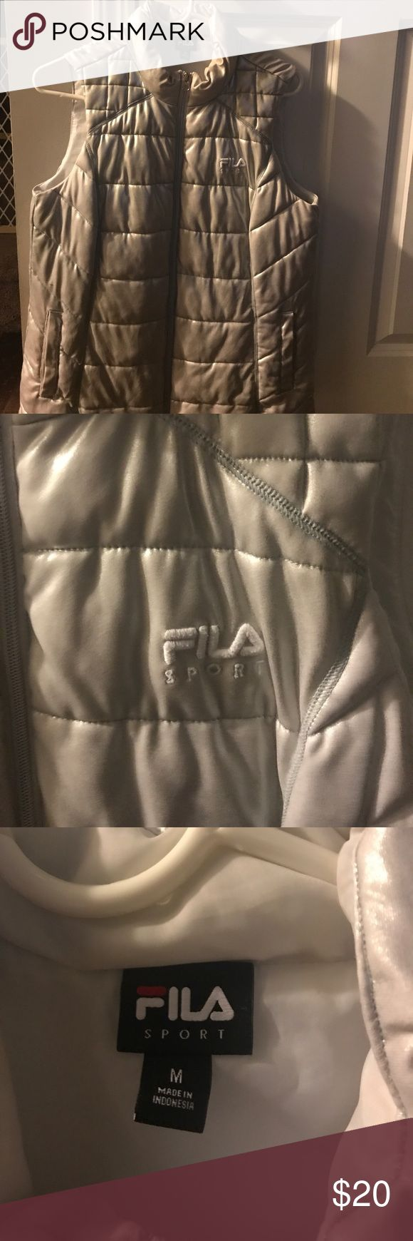 Fila Sport Vest Silver Fila Vest! Puffy and shiny 🙂 Very warm on cold days! Has two pockets . Zipper works perfectly . One owner from no smoking home. Fila logo stitched on left side of Vest. Fila Jackets & Coats Vests