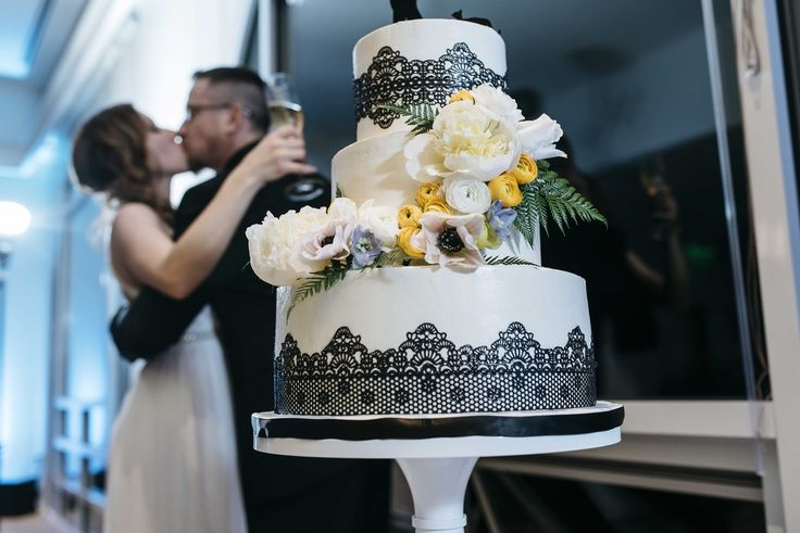 Adorable photo of a champagne toast! The flower cascade adds a touch of elegance to this wedding cake for the vintage-meets-modern bride. Petal Atelier Weddings