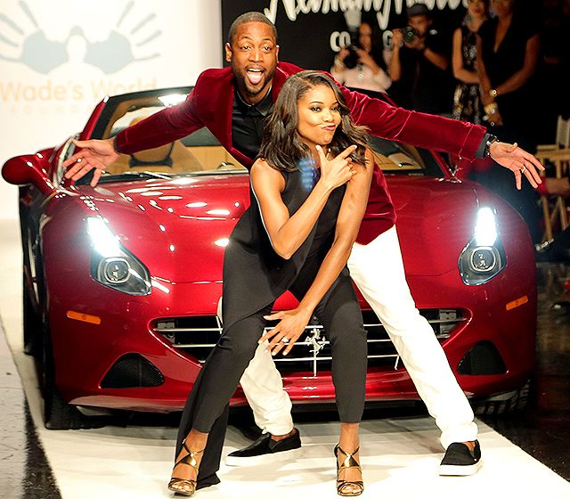 "Newlyweds Gabrielle Union and Dwyane Wade goofed off on the runway at the charity event ""A Night on the RunWade"" to benefit the NBA star's Wade's World Foundation."