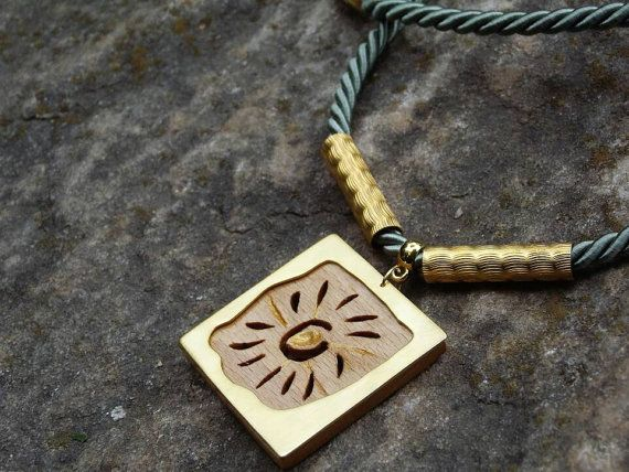 Framed sun necklace by AlphaPiDesigns on Etsy