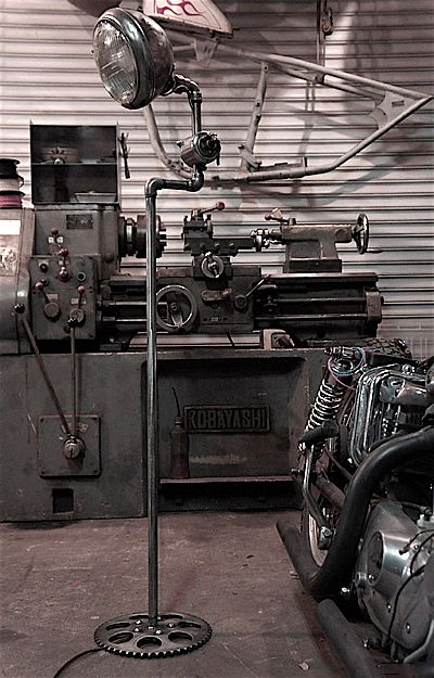 This I love. Typifies the ingenuity of the garage mentality. Sprocket Lamp, burning out his fuse up here alone.... only if you wire it up wrong. Jayde Deverson - Garage Mahal International