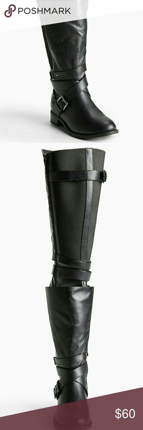 "Torrid Multi Buckle Strap Gore Tall Moto Boots New with Box  Torrid Multi Buckle Strap Gore Tall Black Moto Boots  Wide Width and Wide Calf   Size 9.5  Heel Height 1.5""  Boot Shaft 16.5""  Calf Fit 19.3""  App Will Not Allow Full Size of Pics. Please Refer to Measurements for More of an Accurate Size of these Tall Boots Torrid Shoes Combat & Moto Boots"
