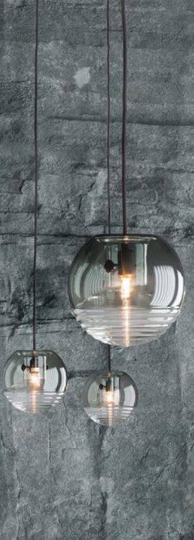 The Tom Dixon Flask Pendant is like a mysterious chemistry experiment, a spherical object made up of two, hand- blown, glass components; flask and hood.
