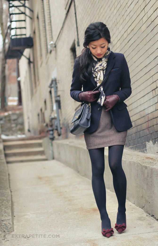 Fitted coat, patterned scarf, and hip-skimming pencil skirt with tights.
