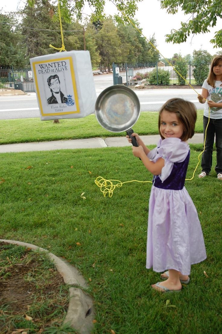 Tangled birthday party.  Cute idea to use a frying pan instead of a stick for the pinata! @Sarah Bohy i found it!