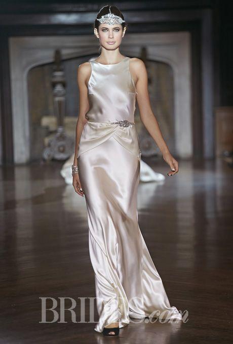"Brides: Johanna Johnson - Fall 2014. ""Garbo"" sleeveless silk sheath wedding dress with a high neckline and beaded detail at the hip, Johanna Johnson"