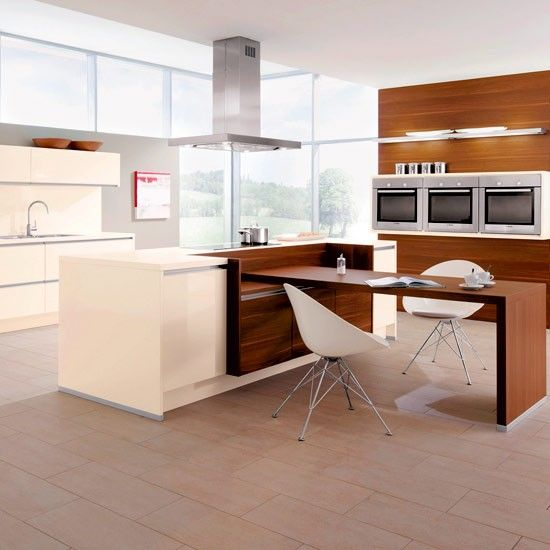 Dont fancy bar stools? When designing your kitchen island unit why not allow for an integral table to form a seating area. http://www.housetohome.co.uk/room-idea/picture/kitchen-diner-ideas/27