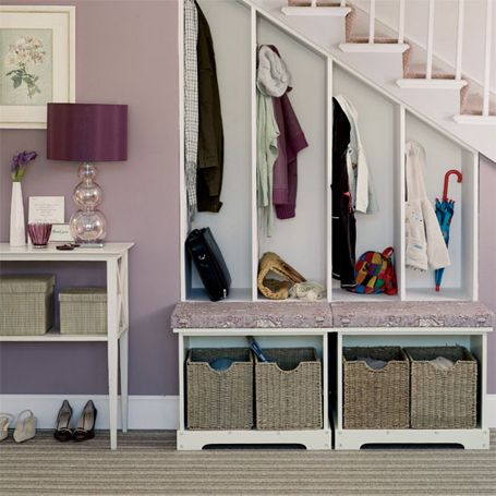 Clever use of under the stairs wasted space. built in nooks with bench in front of it
