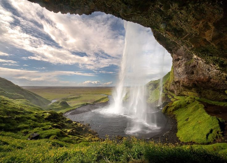 Seljalandsfoss Waterfalls in Iceland by Yuri Ovchinnikov