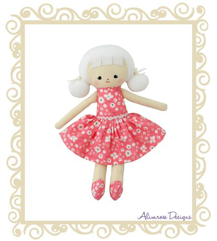 http://www.buttonbaby.com.au/alimrose-designs-audrey-doll-cherry-blossom-p-1769.html - Alimrose Designs Audrey Doll in sweet cherry blossom dress.  Cute pig tails and bows in her hair.  Approx 25cm.