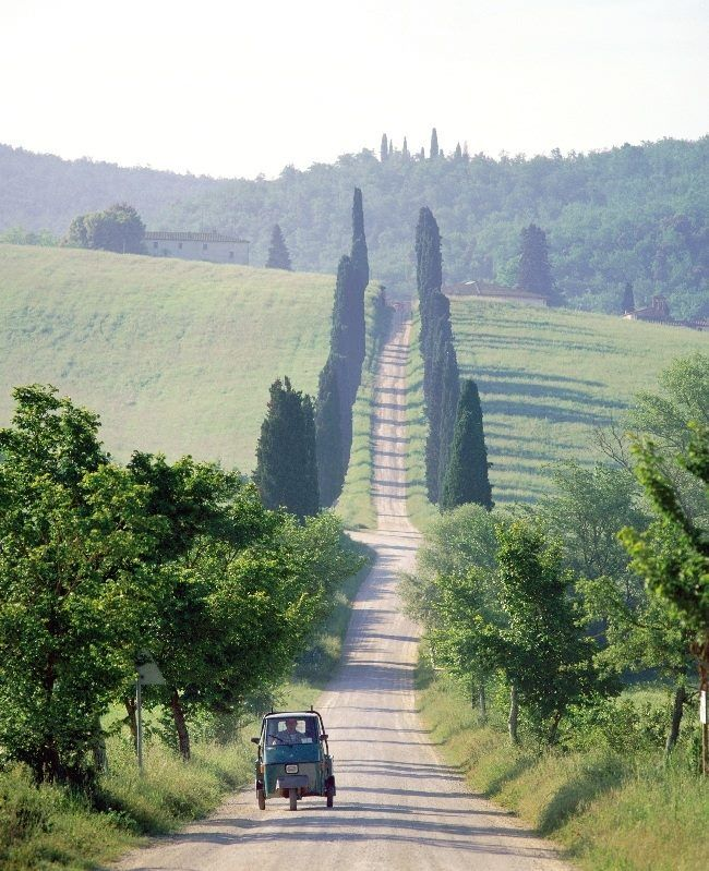 Ah, Tuscany! I saw a few of these little...vehicles...puttering around the countryside. Sigh. :)