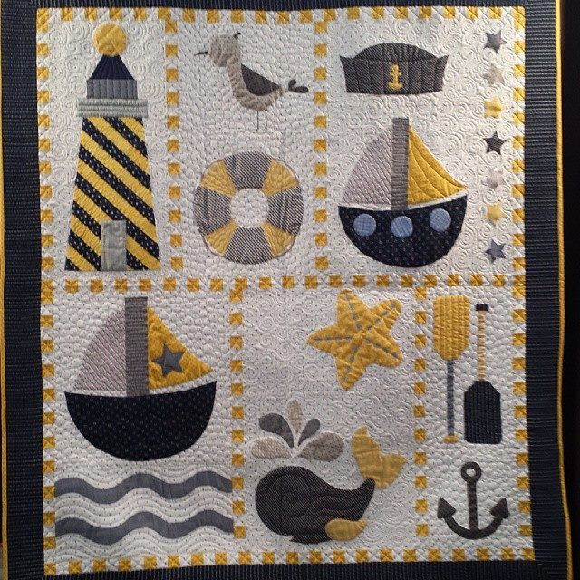 Cute Nautical Quilt!  I'd try to find something else instead of two boats.  but love the color combo.