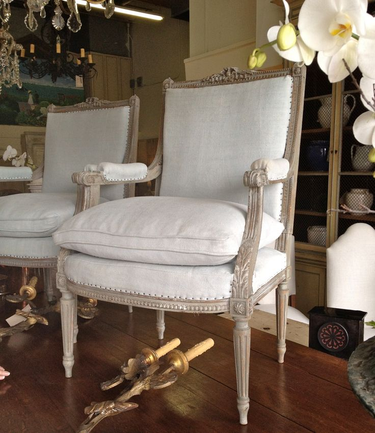 great white washed look, upholstery tack detail, linen color.