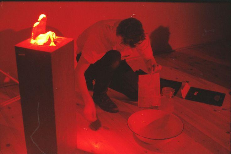instalace a performance Milostné dopisy/Love letters instalation and performance by Tereza Černá (ateliér jako temná komora a pod světlem se rozpouští soška z másla/studio as a dark chamber and light melts a little butter statue)