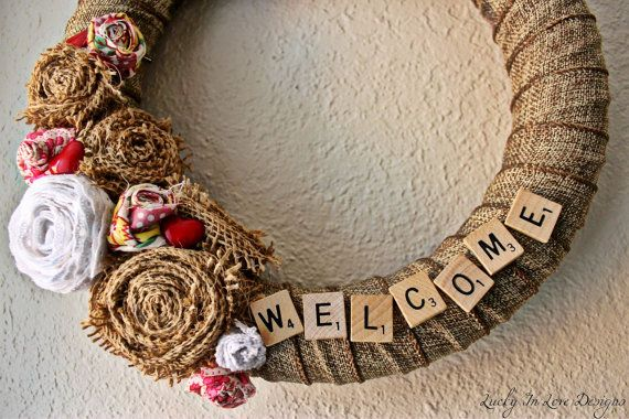 """Burlap Wreath with Fabric Flowers, Heart Buttons, and """"Welcome"""" in Scrabble Tiles, 18"""" on Etsy, $27.00"""