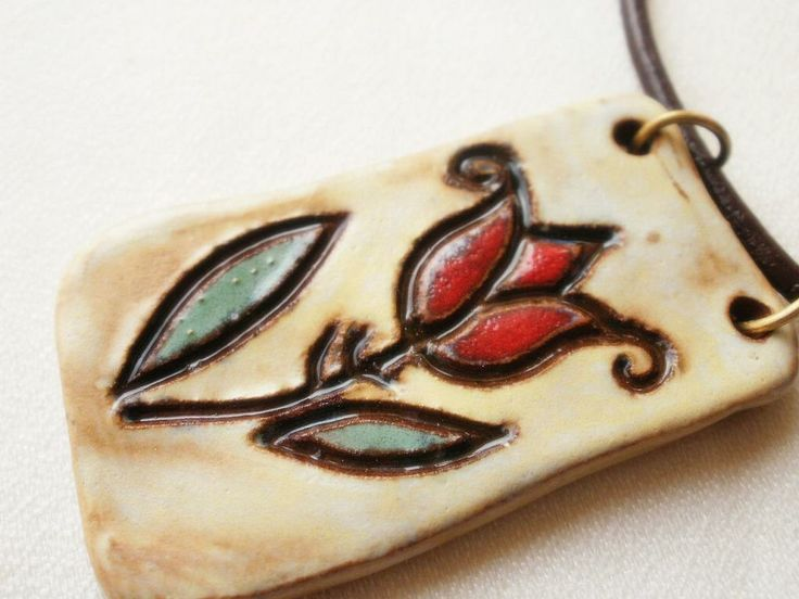 Scratched glazed ceramics chain , tulip with a sample