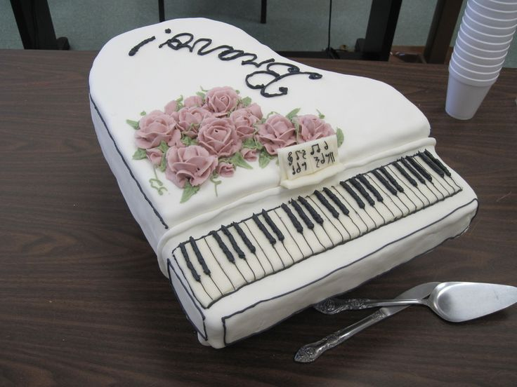 Lemon WASC cake with Raspberry cream cheese filling. Covered in fondant. Buttercream flowers, modeling chocolate keyboard and music stand with piping in black royal icing. Made the shaped board from MDF and screwed in dowels on the bottom. Thanks for looking!