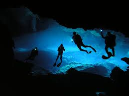 Cave diving - a branch of underwater diving which requires special training and certification.  There are several submerged caves in Australia as well as some extensive networks through the Amazon basin.