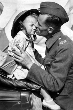 A farewell kiss - a WWII soldier kissing his daughter goodbye before