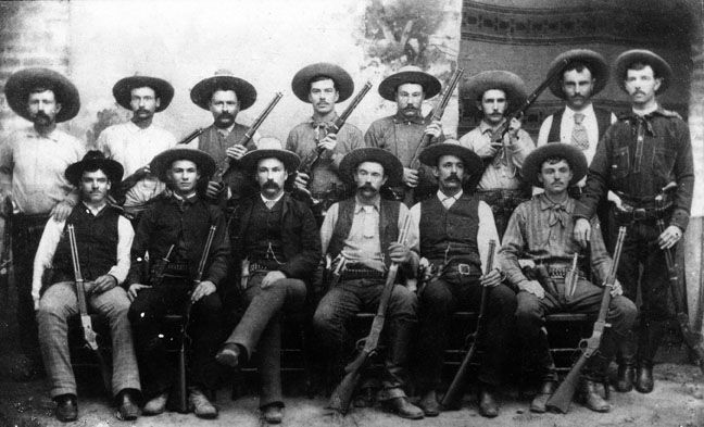 Texas Rangers, south Texas, mid 1880s; posing with  their Winchesters.