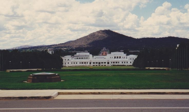 A photo of Old Parliament House taken from Parliament House.  The Australian War Memorial and Mount Ainslie are in the background.