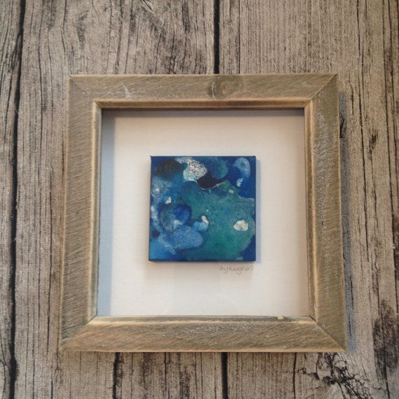 Canvas in Wooden Frame Wonderment 2016  An original mini abstract mixed media painting created as part of a new range of paintings. I usually apply my painting techniques to incredibly large canvases but Ive made these just perfect for your home.  The canvas painting measures 10x10cm and comes in a wooden frame 23.2 x 23.2 x 3.5 cm. It is ready to hang as soon as you receive it.  It would make an ideal gift as it is a unique painting.  More information about the myself the artist at…
