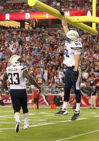 Tight end John Phillips #83 of the San Diego Chargers throws the football through the goal pose after scoring a 3 yard touchdown on a fumble recovery against the Arizona Cardinals during the preseason NFL game at the University of Phoenix Stadium on August 24, 2013 in Glendale, Arizona. (Photo by Christian Petersen/Getty Images)