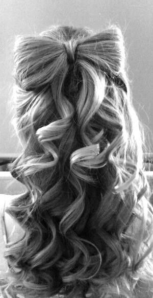 This is how Alice's hair would look like. Just like how Alice's hair is, we all imagine, it is down, the only difference is, it is curled with a bow in it. I think it matches Alice's personality really well. I also think it would look good with her dress. This hair style looks fun and when I see it, I think of Alice for Alice in Wonderland.