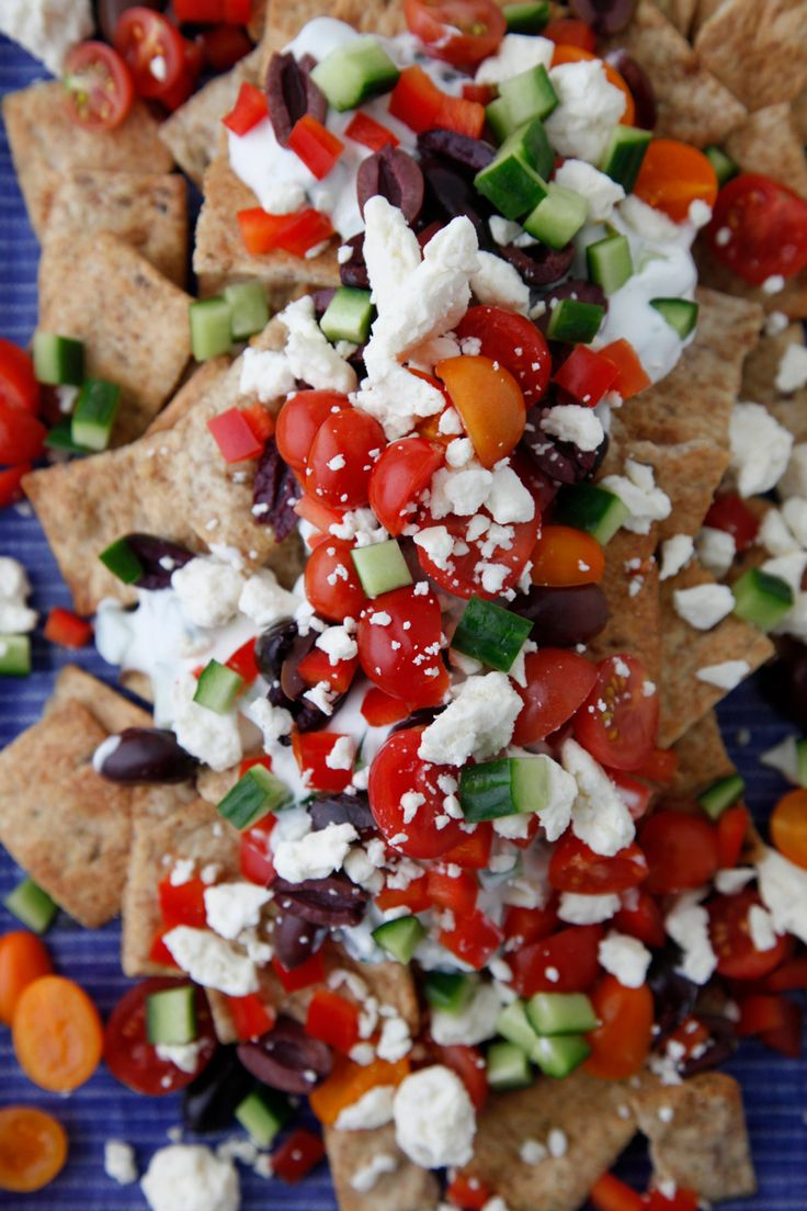 Watch this Greek Nachos video for how to make an epic game day snack! Recipe pinned from Weelicious.com