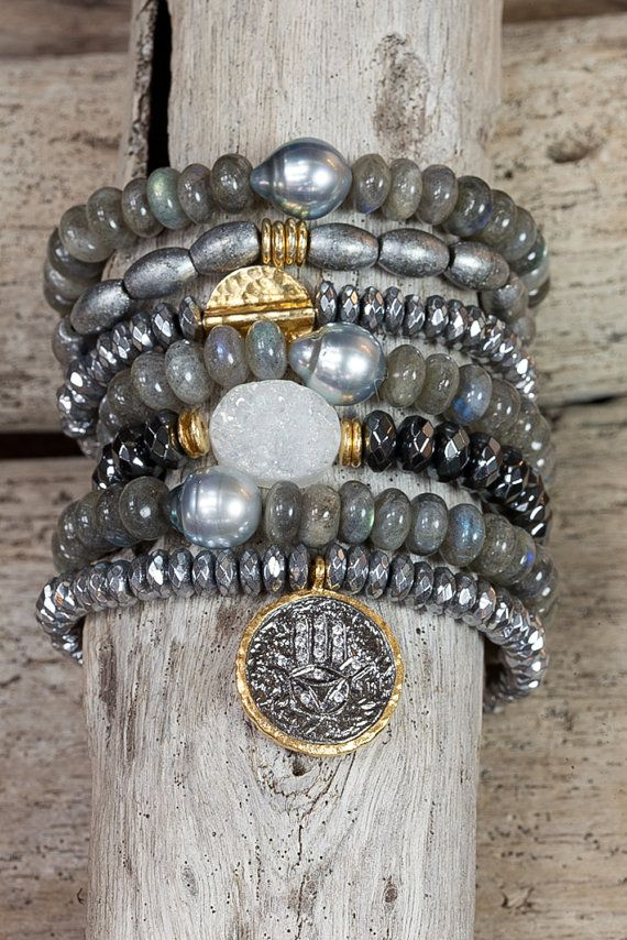 This bracelet is perfect to layer with other bracelets. A hammered 24k gold over silver circle is surrounded by silver coated hematite stones. It is so shimmery