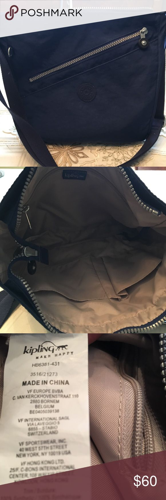 Kipling crossbody Kipling crossbody, called wilbert. In ink blue, missing monkey other then that in excellent condition. Main zipper, with one outside zipper and slip pocket. Inside has zipper pocket with two side pockets and key strap Kipling Bags