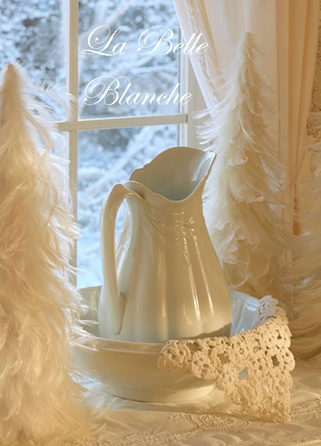 white feather trees and an antique pitcher ..WONDERFUL