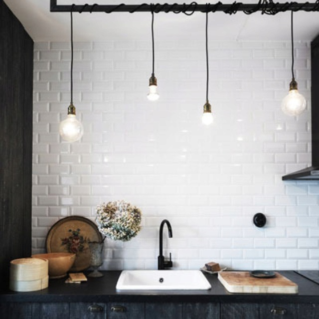Subway tiled kitchen with bare bulb pendants