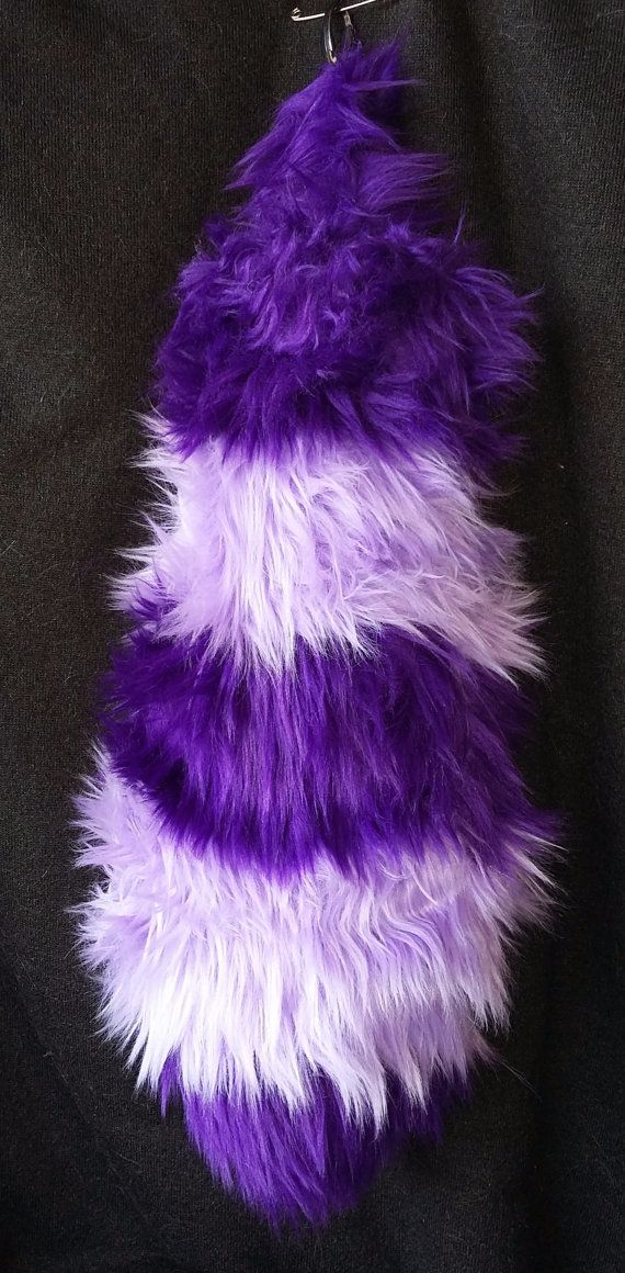 This tail is inspired by the character Bing Bong. With alternating lavender and purple shaggy fur, this tail is 18 long and 4 wide. It is stuffed