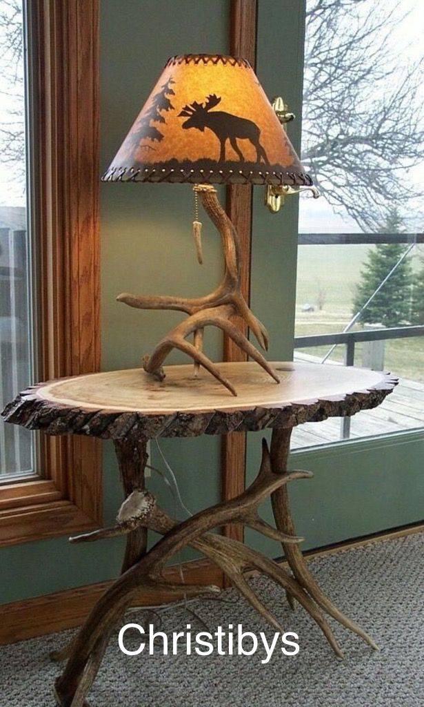 Sofa table on large western Elk legs, slab log polished top, lamp sold. Available, Christibys