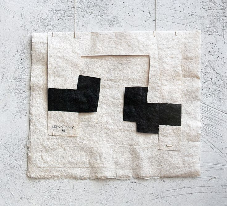 Eduardo Chillida (1924-2002) Gravitación (untitled/number not known), 1989. Cut paper, black ink and cord. 19.5cm H x 23.2cm W.