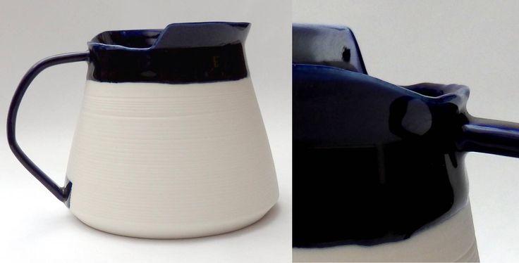 porcelain jug form w angled handle, asymmetric edge