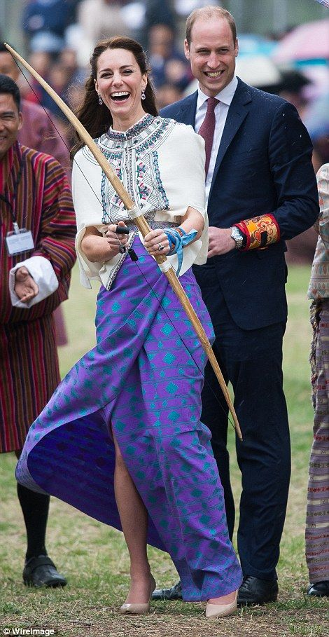 Duchess of Cambridge and Prince William react are taking part in archery at Thimphu's open...