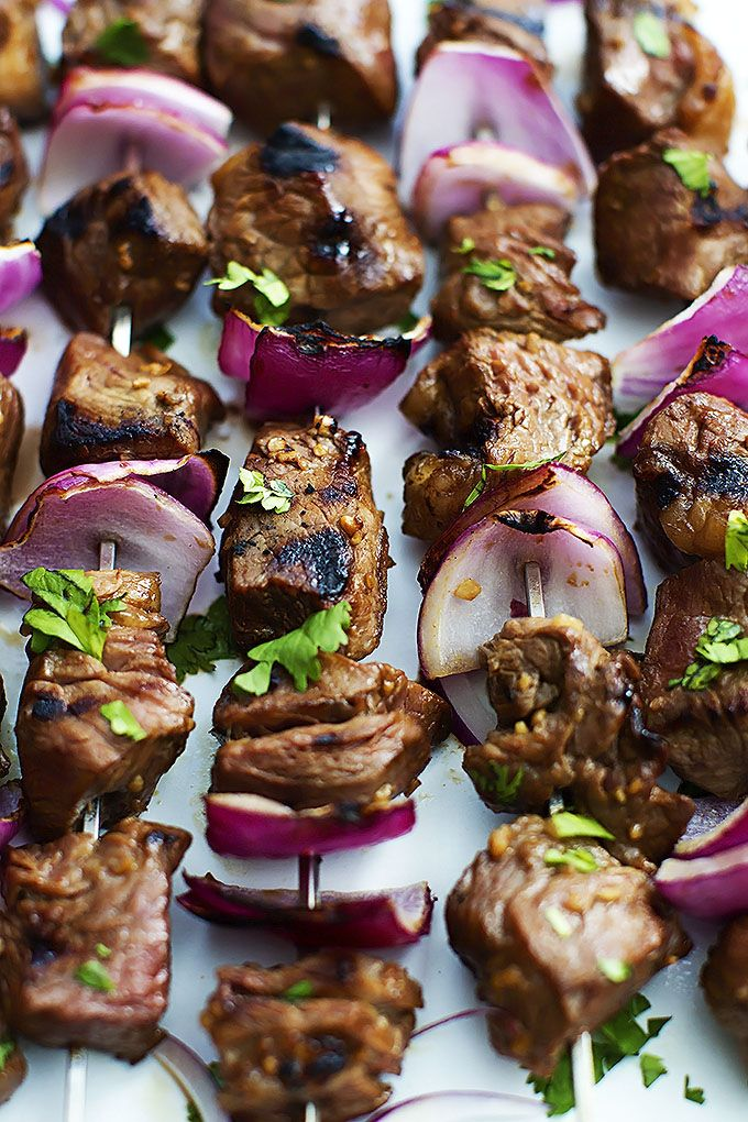 Grilled Steakhouse Kabobs - Juicy steak pieces tenderized in a savory garlic marinade, then skewered with onions and grilled to perfection!