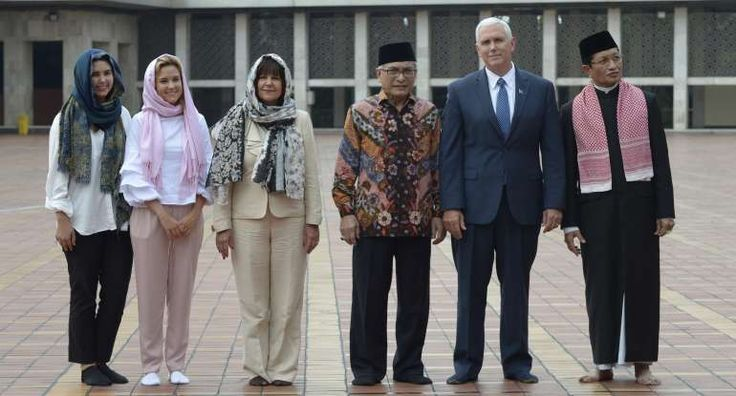 Pence removed his shoes while wife Karen Pence and daughters Audrey and Charlotte donned headscarves in the mosque