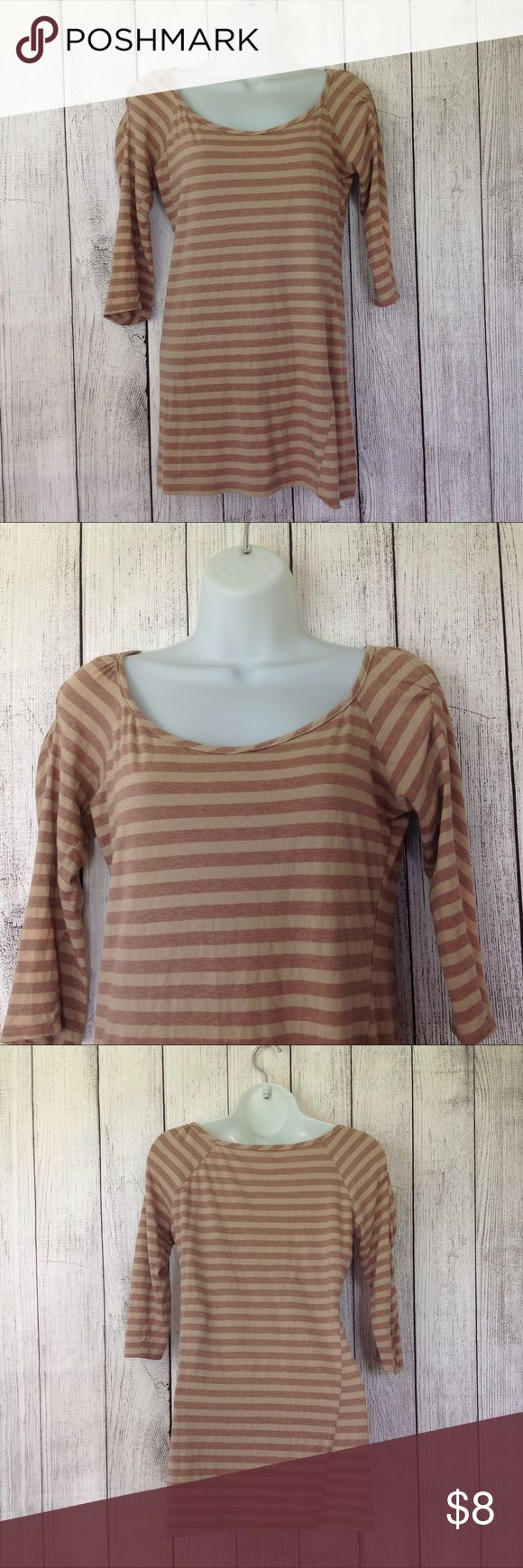 """Charlotte Russe Striped Fitted Top Maker: Charlotte Russe ♥ Material: Rayon ♥ Color: Tan Striped ♥ Measured Size: Pit to pit- 17"""" Pit to cuff- 12"""" Shoulder to waist- 26"""" ♥ Tag Size:  M ♥ PLEASE CHECK YOUR ACTUAL MEASUREMENTS TO MAKE SURE IT IS THE RIGHT SIZE! THANKS!  ♥ Condition: Great Used Condition ♥ Item #: (office use only) A  Follow us on Instagram and facebook for coupon codes!  INSTAGRAM-thehausofvintage1984 Facebook- intergalactic haus of vintage 1984 or @hausofvintage1984…"""