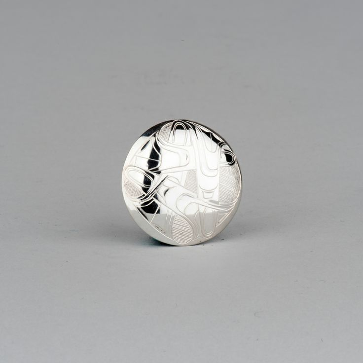 Three Killer Whales pendant in sterling silver by Haida artist Marcel Russ