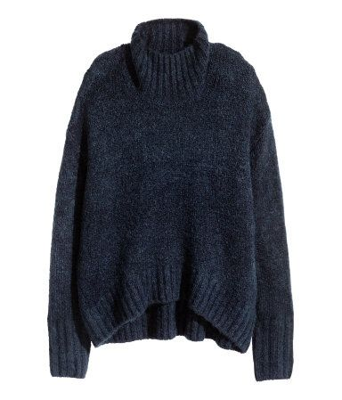 Dark blue melange. Wide-cut knit sweater in a soft wool blend with a ribbed turtleneck. Dropped shoulders, long sleeves, and ribbing at cuffs and hem.