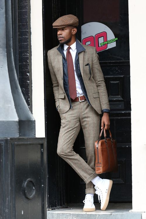 Shop this look on Lookastic:  http://lookastic.com/men/looks/high-top-sneakers-briefcase-tie-dress-shirt-barn-jacket-belt-socks-flat-cap-suit/444  — White High Top Sneakers  — Brown Leather Briefcase  — Burgundy Polka Dot Tie  — White Dress Shirt  — Navy Barn Jacket  — Brown Leather Belt  — White Socks  — Brown Plaid Flat Cap  — Grey Plaid Wool Suit